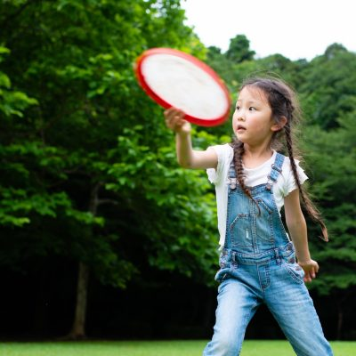 Girl playing with frisbee