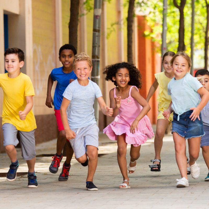 Activity children compete in the summer city street